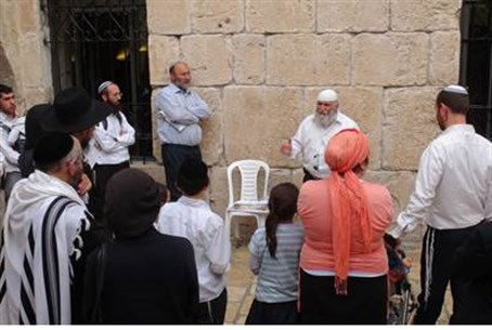 Rabbi Sevilia guides visitors to Tomb.