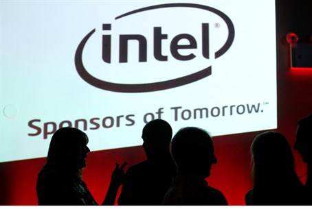Israelis stand in front of Intel logo (file)