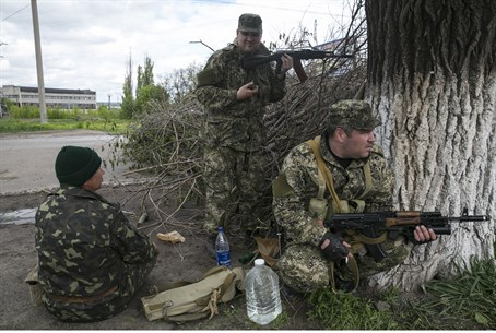 Pro-Russian armed men take positions near the