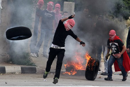 Arab rioters roll burning tires for 'Nakba Da