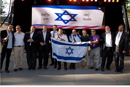 Artists and organizers on stage after the Isr