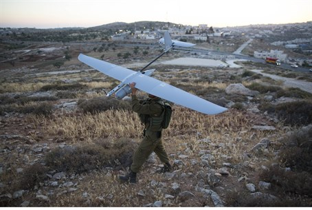 IDF soldier prepares to launch a drone as par
