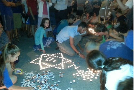 Lighting memorial candles at the Gush Etzion