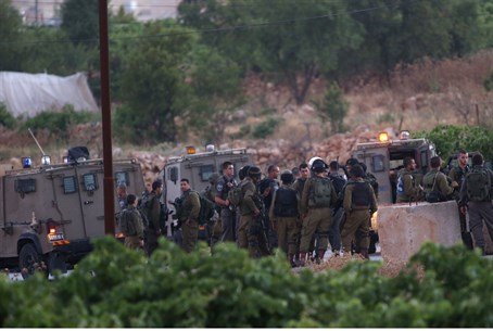 IDF forces outside Halhoul, where the boys' b