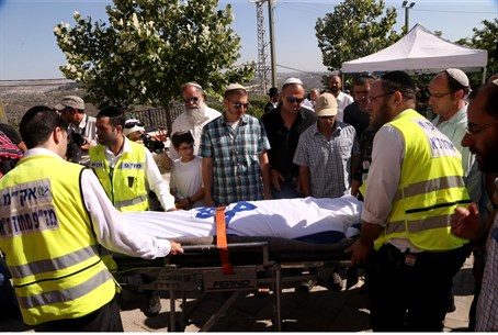 The body of Gilad Sha'ar is transported from