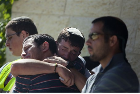 Friends and relatives of Gilad Sha'ar comfort