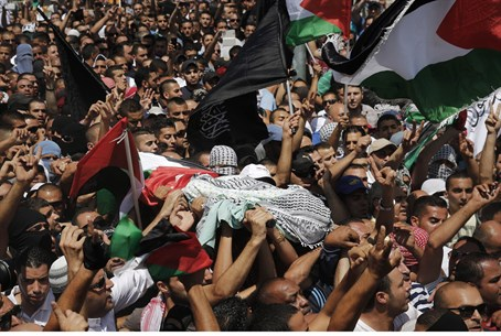 Mourners carry the coffin of Mohammed Abu-Kde
