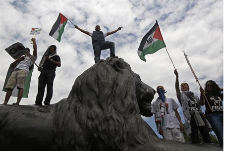 Anti-Israel demonstrators stand on iconic bro