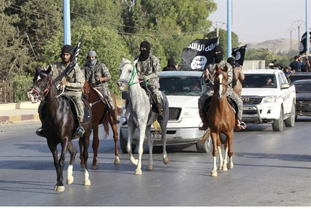 Islamic State terrorists parade through Raqqa