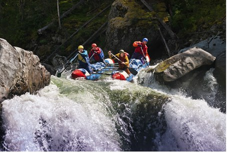 The raft capsized after hitting rapids