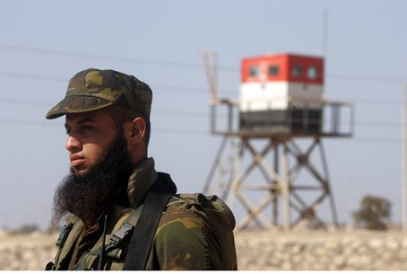 Hamas guard with Egyptian border post