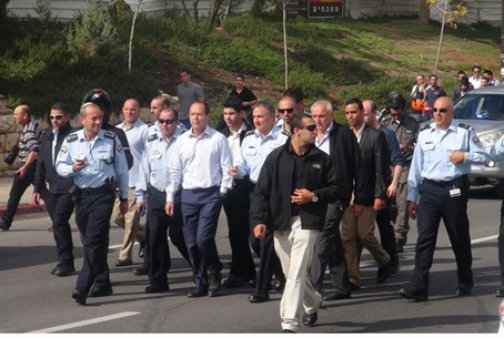 Barkat (C) with senior police at the site of