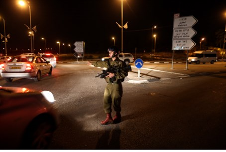 IDF soldier on guard on site of the attack