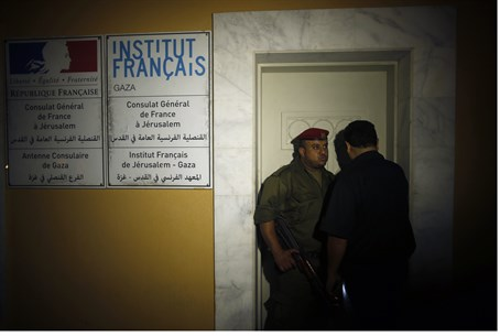 Hamas police outside French Cultural Center in Gaza following bombing