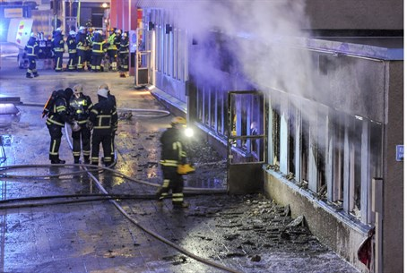 Smoke billows from the windows of a mosque in Eskilstuna