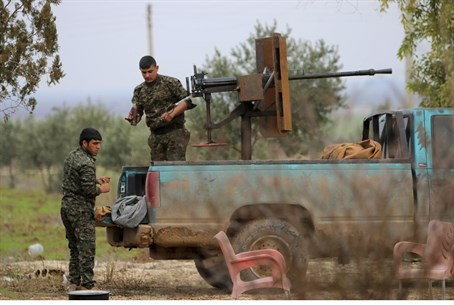 Kurdish YPG fighters on the frontline against ISIS in Ras al-Ain, northern Syira