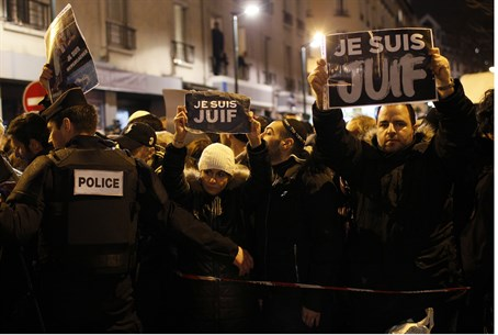 "Demonstrators hold up signs reading ""I am Jewish"" in Paris"