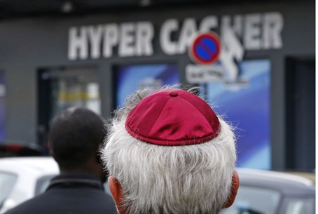 People pay tribute outside the Hyper Cacher store targeted by terrorist Amedy Coulibaly
