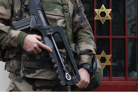 Critical mass: French soldiers guard a Jewish institution in western Paris.