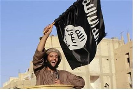 ISIS terrorist with flag (file)