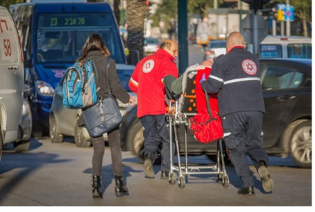 Magen David Adom  workers rush a stabbing victim in Wednesday's terror attack to a hospita