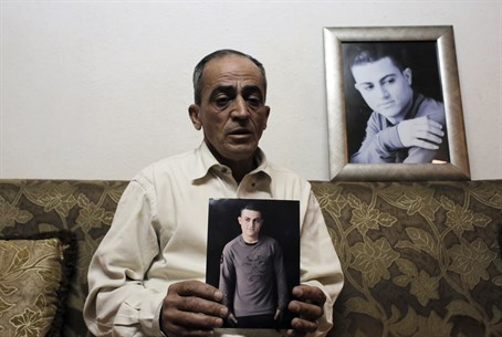 Mohammed Musallam's father with his photos