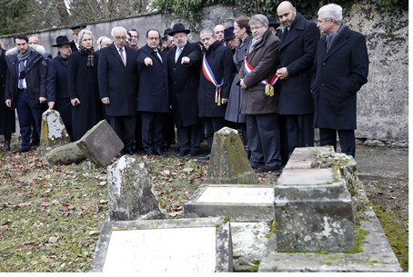 French President Francois Hollande views desecrated Jewish graveyard along with Jewish lea