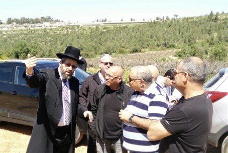 Rabbi David Lau in the field