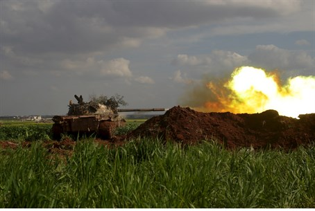 Islamist rebels direct tank fire towards regime forces in Syria's Idlib