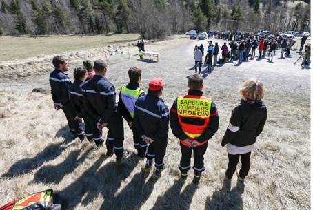Rescuers stand by as relatives of Germanwings crash victims pay respects at memorial