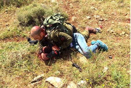 First Sgt. Leitman tackles terrorist.