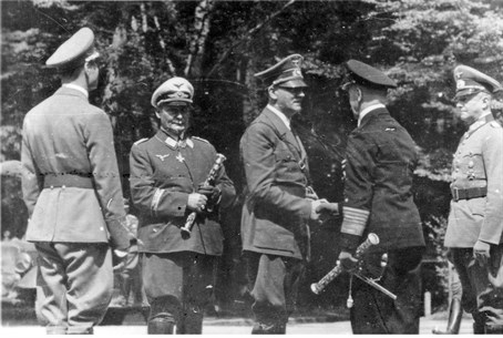 Hermann Goering (2nd L) with Adolf Hitler (C)