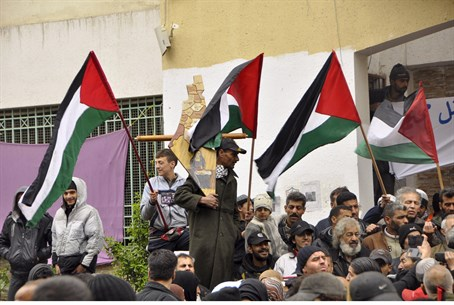 Residents of Yarmouk wave PLO flags