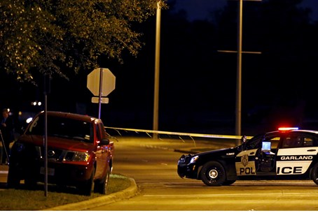 Police stand near terrorists' vehicle in Texas