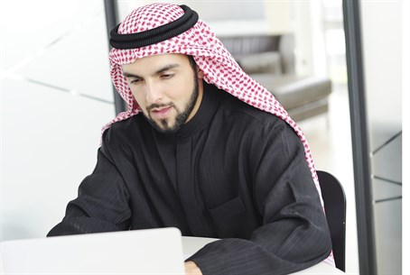 Arab man using a computer (illustration)