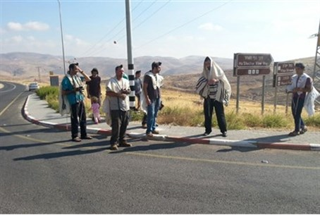 Kochav Hashahar residents pray at murder site.