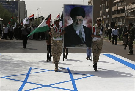 Quds Day march on Israeli flag with Ali Khamenei's picture (file)