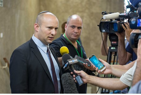 Naftali Bennett speaks to reporters