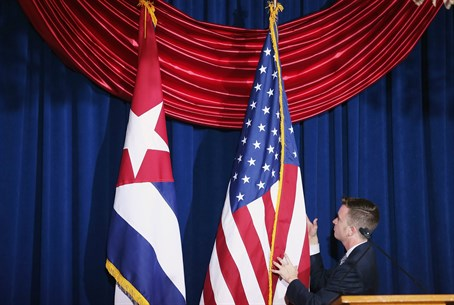 Cuban and American flags straightened during re-opening ceremony Cuban embassy in Washingt