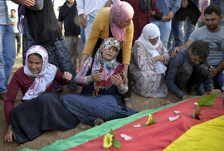 Relatives grieve over coffin of Turkey suicide bomb victim