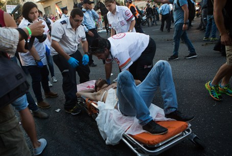 Paramedics treat victims of Jerusalem gay parade stabbing