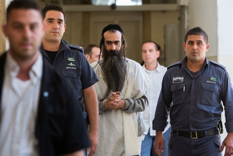 Center: Yishai Shlissel attending court hearing