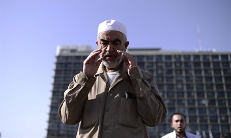 Sheikh Raed Salah prays in Tel Aviv's Rabin Square