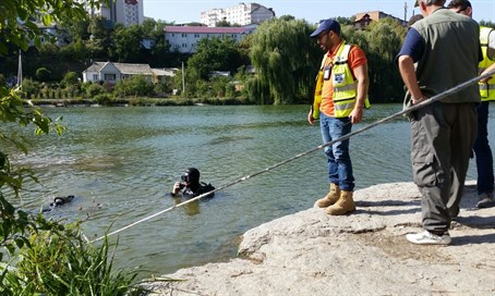 ZAKA searches in Uman river for Amir Ohana
