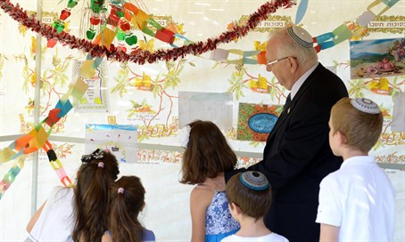 Rivlin and friends decorate 'the Nation's Sukkah'