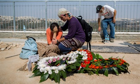 "Israelis mourn at the graves of Rabbi Eitam and Naama Henkin, hy""d"