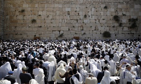 Jews worship at the Kotel (Western Wall)