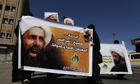Protesters carry posters of Sheikh Nimr al-Nimr