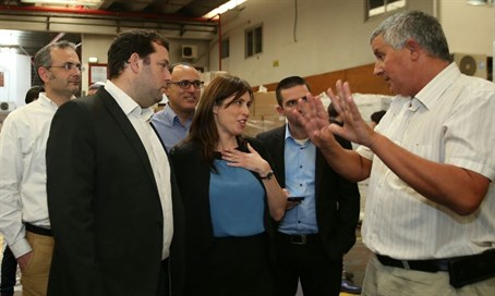 Tzipi Hotovely speaks to workers in Barkan