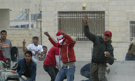 Arab rioter throws bottle (illustration)